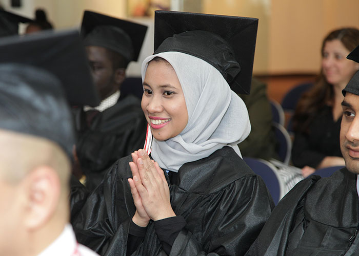 smiling student in audience