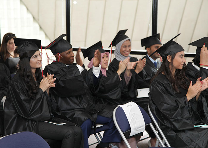 graduates clapping in audience